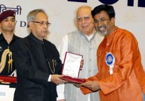 The President of India Pranab Mukherjee presents 60th National Film Award to Kannada film director P Sheshadri for his movie Bharath Stores during 100 years of Indian Cinema celebrations in New Delhi on Friday.
