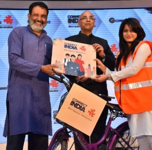 Dr. Mohan Das Pai, Chief Guest for the launch ceremony of Connect India getting first shipment  from Mr. LR Sridhar, Founder & CEO