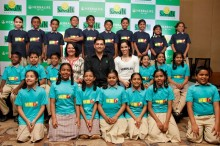 L-R, Mrs.Smita Kalappa- VP Resources  and Sustainability,Smilefoundation, Ajay Khanna- Vice President & Country Head,  Herbalife International India, Saina Nehwal with the kids from Smile Foundation