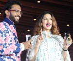 Bollywood actress Sunny Leone seen with Rahul Vinayika, MD of RZ International Pvt Ltd during the launch of Gold Fogg, an energy drink in Bengaluru on Sunday
