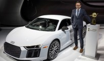 "Roland Schala, Audi R8 Project Manager, with the R8 Coupé and the ""2016 World Performance Car"" award."