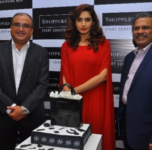 (L-R) Mr.Vishal Mirchandani, CEO-Retail & Commercial, Brigade Enterprises Ltd, Actress- Ragini Dwivedi, Mr.Govind Shrikhande, Customer Care Associate & MD, Shoppers Stop Ltd at Shoppers Stop's new store at Orion Mall