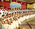 A group of newly married 20 couples at the dowry-less social wedding organised by Sri Kurumba Educational & Charitable Trust at Sri Kurumba Kalyana Mandapam, Moolamcode in Palakkad, Kerala.