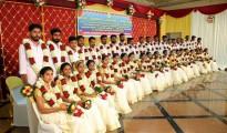 A group of newly married 20 couples at the dowry-less social wedding organised by Sri Kurumba Educational & Charitable Trust at Sri Kurumba Kalyana Mandapam, Moolamcode in Palakkad, Kerala.