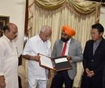 Cheque handover to Sh. B. S. Yediyurappa, Hon Chief Minister of Karnatak...