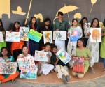 Students showcase their splash paintings on sustainable integration