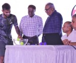 Sumit Nagal (left) picks up a ball during the draw ceremony at the KSLTA on Friday. Also seen are Mr. M. Lakshminarayana, IAS, Vice President, KSLTA and Advisor to the Honorable Chief Minister, Govt. of Karnataka, Tournament Director Sunil Yajaman and ATP Supervisor Andrey Kornilov (extreme right)