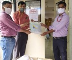Team DFPCL handing over PPE kits to Haffkine Institute