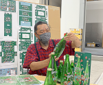 Takashi Murakami giving a final check to the PERRIER X MURAKAMI BOTTLES