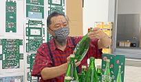 Takashi Murakami giving a final check to the PERRIER X MURAKAMI BOTTLES