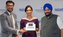 Mr. Sachin Jain, MD, De Beers Inda, Film star, Srinidhi Shetty and Gurmukh Singh, CEO, Neelkanth Jewelers